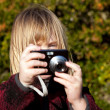 Child photographer photographing taking photo — Stock Photo