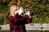 Child photographer photographing taking photo — Stock Photo