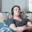 Stock Photo: Relaxing sleeping in chair headphones