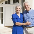 Senior couple outside house - Stock Photo