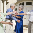 Senior couple greeting friends — Stock Photo #4752880