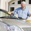 Senior man washing car — Stock Photo