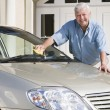 Stock Photo: Senior man cleaning car