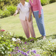 Senior women in garden - Stock Photo