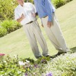 Senior men standing in garden - Stock Photo