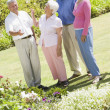 Group of senior friends in garden — Stockfoto