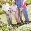 Stock Photo: Group of senior friends in garden Group of senior friends in gar