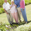 Group of senior friends in garden — Stock fotografie