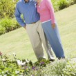 Senior couple standing in garden — Stock Photo #4752931