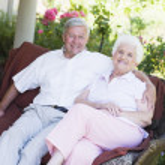 Senior couple relaxing on garden seat — Stock Photo #4752937