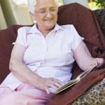 Senior woman reading book — Stock Photo #4752943