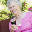 Senior woman enjoying glass of wine — Stock Photo #4752967