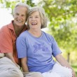 Senior couple relaxing in park — Stock Photo #4753026