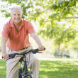 Senior man on cycle ride — Stock Photo
