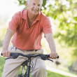 Senior man on cycle ride - Stock Photo