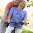 图库照片: Senior couple on cycle ride