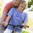 Senior couple on cycle ride — Foto Stock