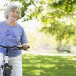 Senior womon cycle ride — Stock Photo #4753043
