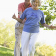 Senior couple having fun in park — Stock Photo