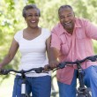 Senior couple on cycle ride - Stock Photo