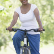 Senior woman on cycle ride - Foto Stock