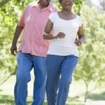 Senior couple having fun in park — Stock Photo