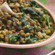 Lentils with spinach and Garlic - Stock Photo