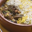 Pot of Lamb Biryani with a spoon - Stock Photo