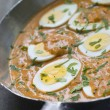 Eggs Cooked Moghali Style in a pan - Stockfoto