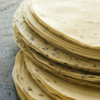 Stack of uncooked Papadoms - Stock Photo