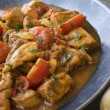 Chicken Bhoona in a Pewter dish - Stock Photo
