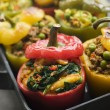 Bell Peppers stuffed with Keema Sag Aloo and Vegetable Pilau - Stock Photo