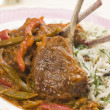 Lamb Cutlet Jalfrezi with Fragrant Pilau and Indian Beer - Stock Photo