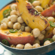 Bowl of Chick Pea and Peach Salad - Stock Photo
