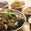 Stock Photo: Meat Madras Restaurant Style with Raitand Chutneys