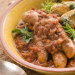 Sausage and Lentil Stew with Pesto Roasted Potatoes - Stock Photo
