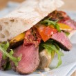 Stock Photo: Sirloin Steak and Roasted Pepper CiabattSandwich