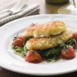 Breadcrumbed Mozzarella Cheese with Roasted Cherry Tomatoes and - Stock fotografie