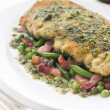 Cotoletta of Veal with Green Beans Peas and Pancetta - Stock Photo