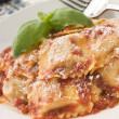 Veal and Sage Ravioli with Tomato and Basil Sauce with Grated Pa — Stock Photo #4753585