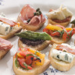 Royalty-Free Stock Photo: Plated Selection of Crostini