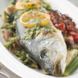 Whole Roasted Sea Bass with Fennel Lemon Cherry Vine Tomatoes an - Stock fotografie