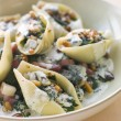 Conchiglioni pasta shells with Spinach Pancetta Pine Nuts and Go - Stock Photo