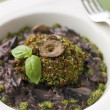 Herb Crusted Portabello Mushroom with Red Wine Risotto and Pesto — Stock Photo #4753706