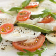 Tomato Avocado and Mozzarella Salad with Olive Oil and Black Pep — Stock Photo #4753729