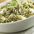 Bowl of Fusilli Pasta dressed in Pesto with Parmesan Shaves — Stock Photo #4753742