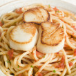Seared Scallops with Chilli and Tomato Spaghetti - Stock Photo
