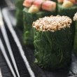 Rolled Spinach Three Ways-Snow Crab Toasted Sesame Seeds and sal - 图库照片