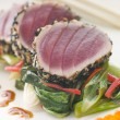 Seared Yellow Fin Tuna with Sesame Seeds Sweet Fried pac Choi an - Stock Photo