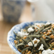 Green Tea Leaves with Brown Rice — Stock Photo